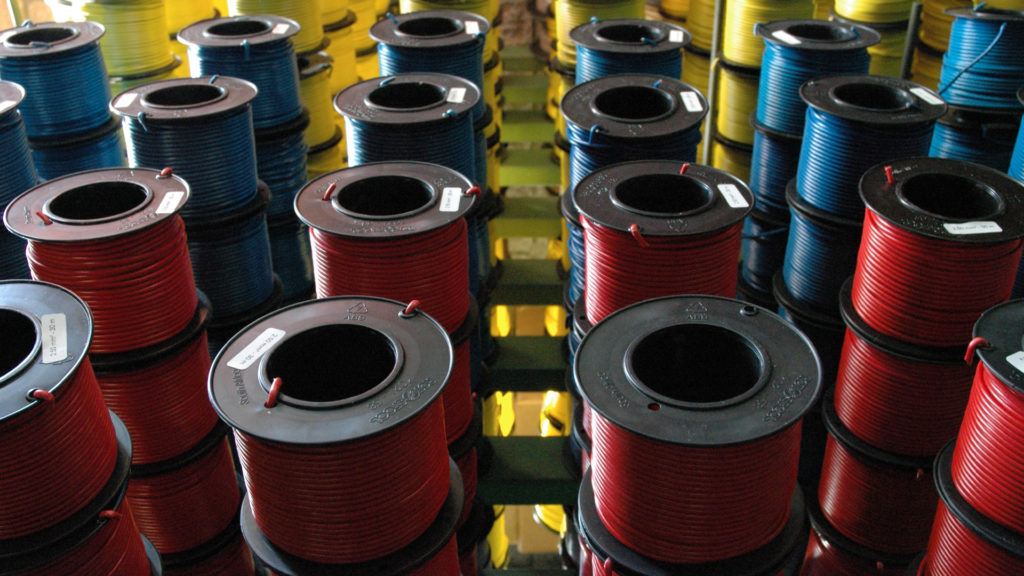 Plastic Spools with wire on a rack